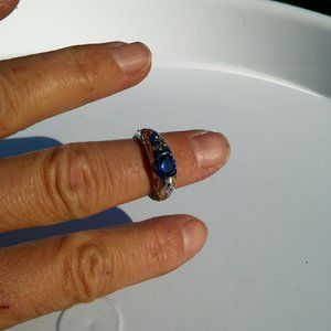 """Women`s marked """"925"""" silver blue stone bee and but"""